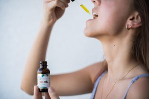 Omnia Naturals CBD oil being administered sublingual