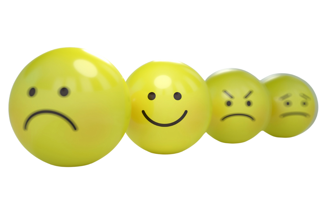 4 yellow balls each with different emotions on them representing sad, happy, angry and anxious.