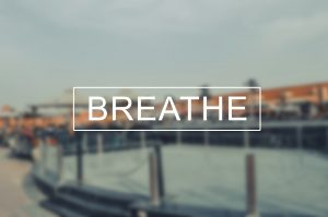 the word breathe laid over a blurred background image
