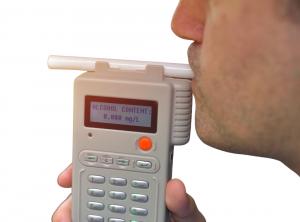 a man blowing into a breathalyzer