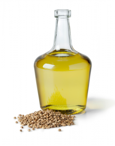 hemp seed oil in a jar surrounded by hemp seeds which are high in omega 3 fatty acids