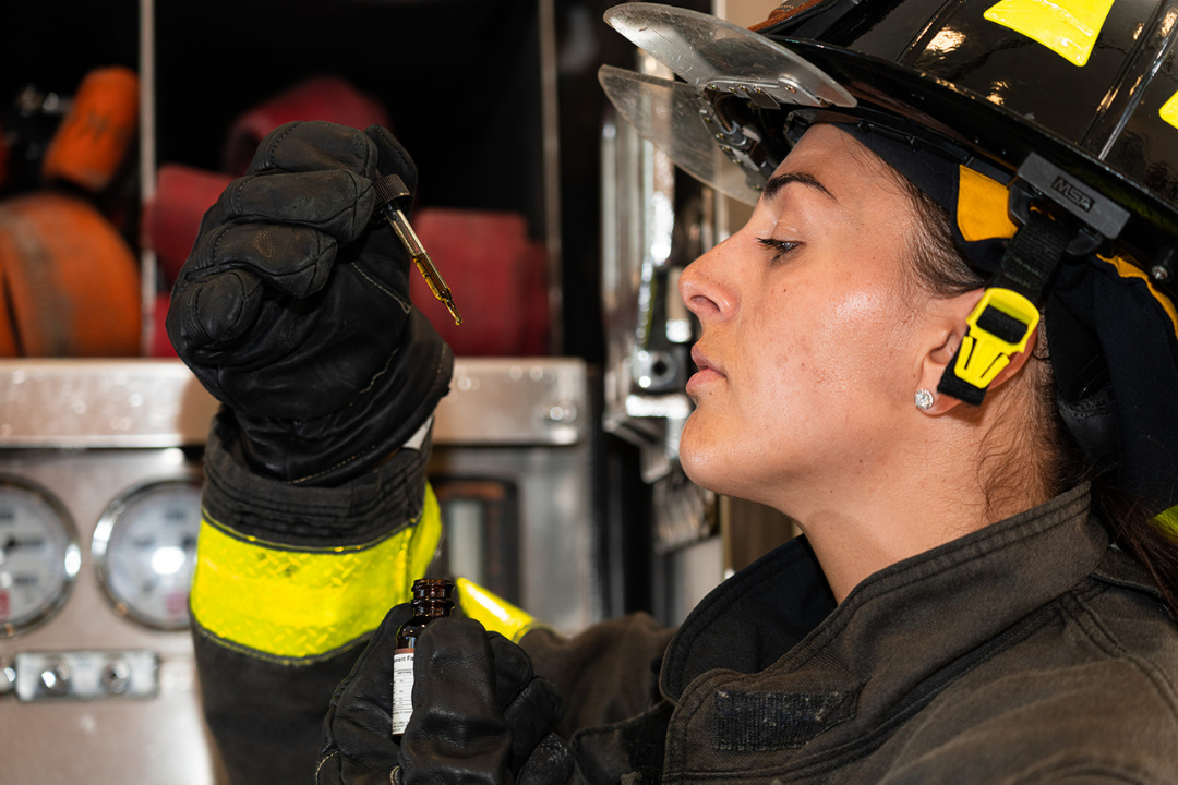 a female firefighter using CBD for first responders